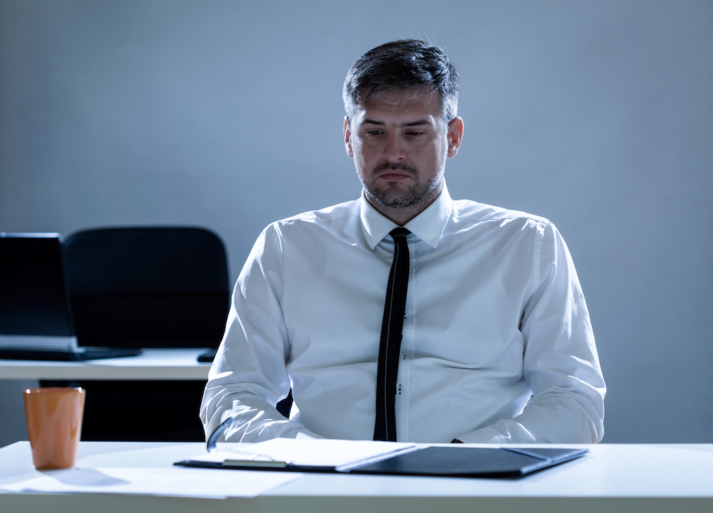 Depressed man,workplace bullying,ostracism